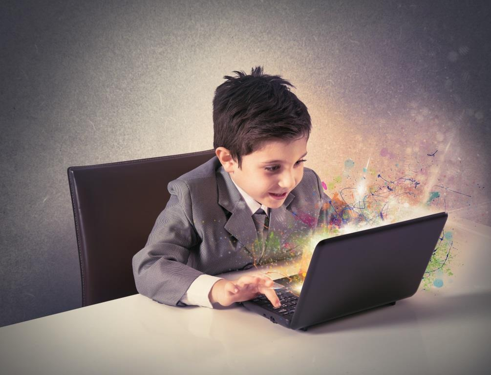 Young boy working with laptop. concept of creativity and imagination
